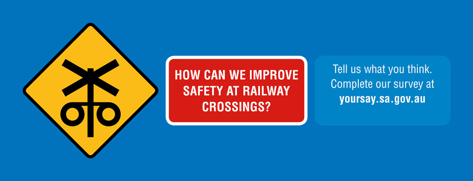 How can we improve safety at railway crossings?